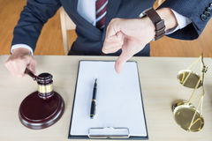 Law court or justice concept. Portrait lawyer making thumb down. Hand Stock Images