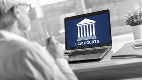 Law courts concept on a laptop screen. Laptop screen displaying a law courts concept stock photography