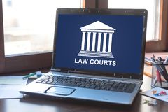 Law courts concept on a laptop screen. Laptop screen displaying a law courts concept stock image