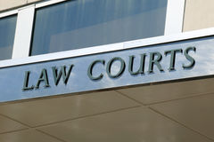 Law courts sign. Positioned above the entrance of a courthouse Stock Images