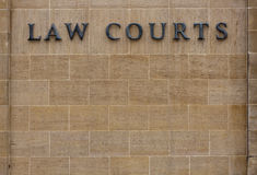 Law courts sign. Law courts sign on an old stone wall with copy space Stock Images