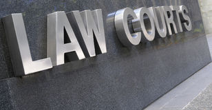 Law Courts sign in stainless steel, courthouse building Royalty Free Stock Photography