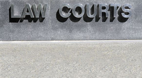 Law Courts sign in stainless steel, courthouse building, copy space Royalty Free Stock Image