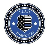 Law Enforcement Appreciation Day is celebreted in USA on January 9th each year. Police shild with US flag and L.E.A.D. slogan.