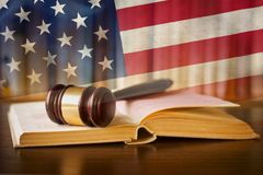 Law enforcement and the judiciary in the US. Law enforcement and the judiciary in the United States with a composite image of a judges gavel on a law book in the stock photos