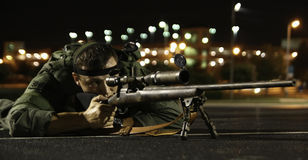 Law Enforcement Sniper in Prone Position. A Cabarrus County Sheriff's Department Sniper taking a prone firing position during an emergency training exercise at a Stock Photos