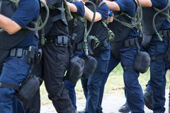 Law enforcement training team with tactical equipment and tactic Stock Photography