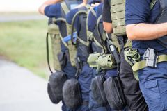 Law enforcement training team with tactical equipment and tactic Stock Photos