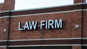 Law Firm Sign. A sign outside of an establishment that provides lawyer and attorney services to individuals that need legal assistance for a fee royalty free stock photography