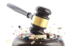 Law gavel beats on tablets and pills,  judge cocept, crime with Stock Photo