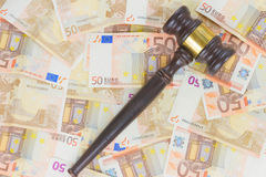 Law Gavel and Euro Money. Wooden Law Gavel and Euro Money Banknotes background Royalty Free Stock Image