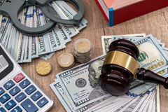 Law gavel with handcuffs, dollars and books as background Stock Images