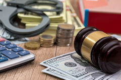 Law gavel with handcuffs, dollars and books as background, Royalty Free Stock Photo