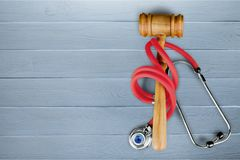 Law gavel medicine. Red grey wood healthcare and medicine malpractice law Royalty Free Stock Photo
