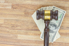 Law Gavel an Money. Wooden Law Gavel with Dollar Money on wooden table background with copy space Royalty Free Stock Images