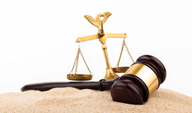 Law gavel. On sand and wkite background Royalty Free Stock Photography