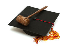 Law Graduate. A mortarboard and gavel are isolated for law graduates Stock Photos