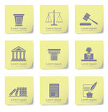 Law icons on yellow slips Royalty Free Stock Photo