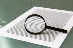 Law investigation, magnifying glass with document Royalty Free Stock Photos