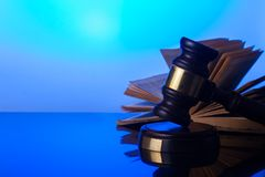 Law and justice concept. Law gavel with open book in background Stock Images