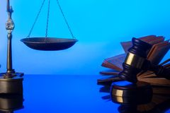 Law and justice concept. Law gavel with open book and vintage scale in background Stock Photography