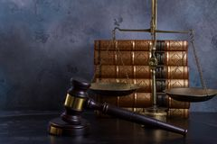 Law and justice concept. Law gavel with scale and row of books Stock Photo