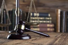 Law and justice concept . Place for typography and logo. Gavel , scale of justice and legal code on wooden rustic table. Brown background Stock Photos