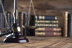 Law and justice concept . Place for typography and logo. Gavel , scale of justice and legal code on wooden rustic table. Brown background Stock Images