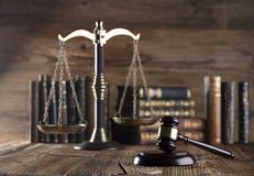 Law and justice concept . Place for typography and logo. Gavel , scale of justice and legal code on wooden rustic table. Brown background Royalty Free Stock Photography