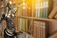 Law and justice concept. Symbol justice scales of justice criminal law goddess statue white background Stock Image