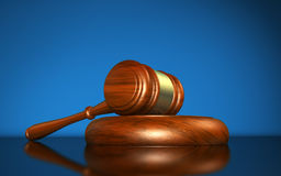 Law Justice And Legal System. Law, justice and legal system concept with a wooden gavel judge symbol on blue background Stock Images