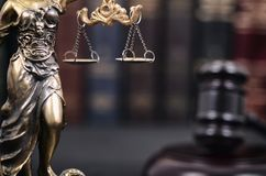 Judge Gavel and Lady Justice on a black wooden background. stock images