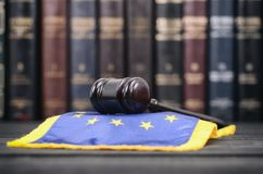 Law library, Judge Gavel and EU flag . Law and Justice, Legality concept, Law library, Judge Gavel and EU flag flag on a black wooden background Royalty Free Stock Images