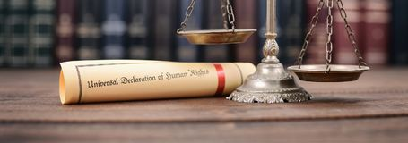 Scales of Justice, Universal declaration of human rights. Law and Justice, Scales of Justice, Universal declaration of human rights on a wooden background, human royalty free stock images