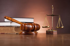 Law and justice stuff on wooden table, dark background Stock Images