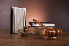 Law and justice stuff on wooden table, dark background Royalty Free Stock Photography