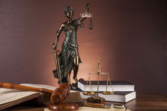 Law and justice stuff on wooden table, dark background Royalty Free Stock Photo