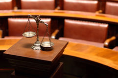 Law and Justice. Symbol of law and justice in the empty courtroom, law and justice concept Royalty Free Stock Photo
