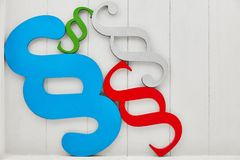 Law Law Justice symbol by paragraph. Law Law Justice symbol through colorful paragraphs against a wood background stock images