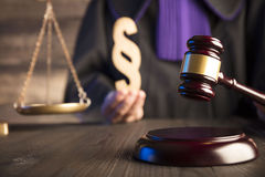 Law and justice theme. Law theme and concept. Mallet in the hand of judge in toga Stock Photos