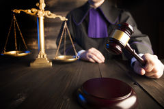 Law and justice theme. Law theme and concept. Mallet in the hand of judge in toga Stock Photo