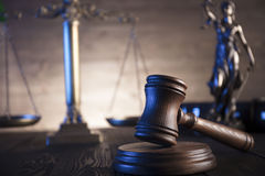 Law and justice theme. Law theme and concept. Mallet of judge and scale of justice on wooden brown table Royalty Free Stock Photos