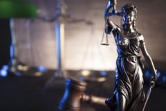 Law and justice theme. Law theme and concept. Mallet of judge and scale of justice on wooden brown table Royalty Free Stock Photography