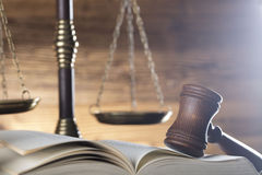 Law and justice theme. Gavel of judge, scale of justice and legal code on wooden background Stock Photography