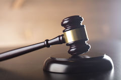 Law and justice theme. Gavel of judge on stone background Stock Photo