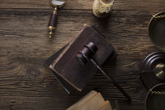 Law and justice theme. Mallet of judge. Legal code. Scale of justice. Wooden table. Top view Stock Photography