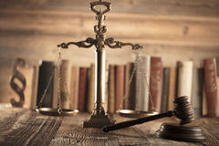 Law and justice theme. Mallet of judge. Scale of justice. Legal code. Wooden table. Stone background Stock Photo