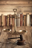Law and justice theme. Mallet of judge. Scale of justice.  Legal code. Wooden table. Stone background Royalty Free Stock Images