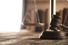 Law and justice theme. Mallet of judge. Scale of justice. Legal code. Wooden table. Stone background Stock Photography