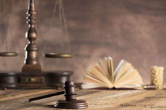 Law and justice theme. Mallet of judge. Scale of justice. Wooden table. Stone background Stock Photo
